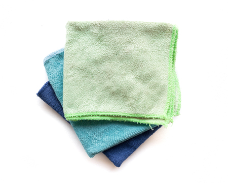 Pile of microfiber cloth for clean on white background, housework concept Stock Photo