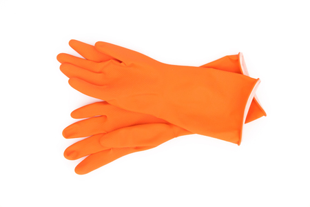Orange color rubber gloves  for cleaning on white background, workhouse concept 스톡 콘텐츠