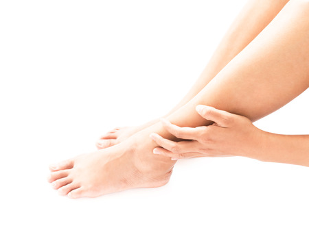 symptom: Closeup woman hand hold legs with pain symptom, health care and medical concept