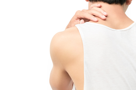Closeup young man neck ache with white background Standard-Bild