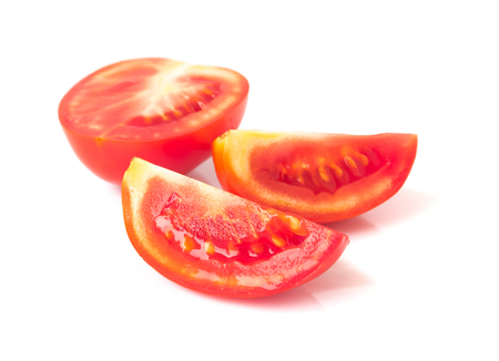 Fresh tomatoe slices on white background, selective focus