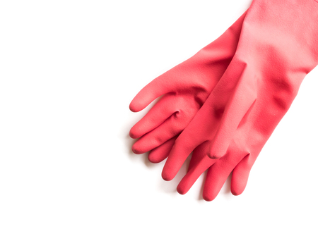 Closeup Red rubber gloves for cleaning on white background, workhouse concept