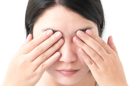 Woman hand closes eyes with eye pain, health care and medical concept Stock Photo