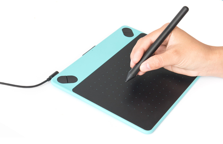 Hand holding pen with digital graphic tablet on white background