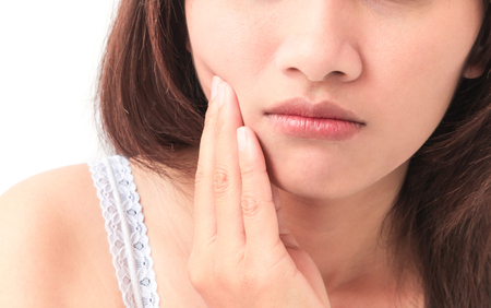 Closeup woman toothache with white background, health care and medical concept 스톡 콘텐츠