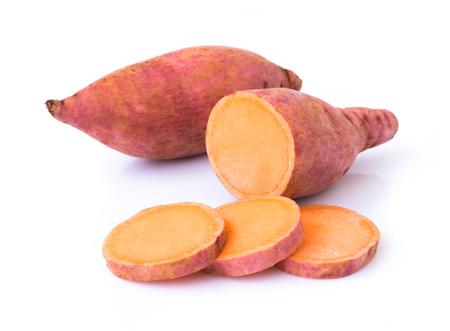 Sweet potato with slices on white background, raw food Stock Photo