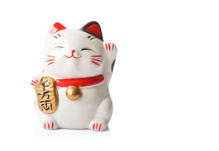 Maneki Neko ceramic japanese lucky cat isolated on white background