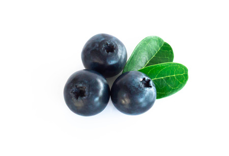 Fresh blueberries with green leaves isolated on white background
