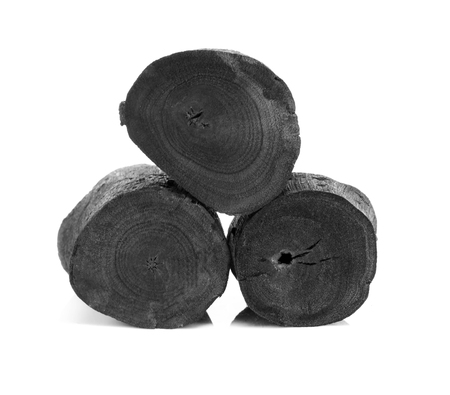 Natural black charcoal isolated on white background
