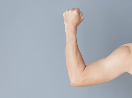 Back arm man with grey background, health care and medical concept