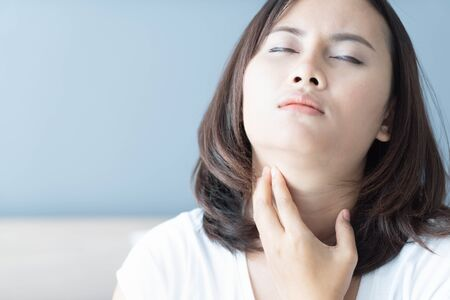 Woman sick with throat sore, health care and medical concept