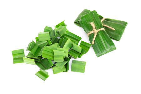 Fresh green pandan leaves with slice isolated on white background