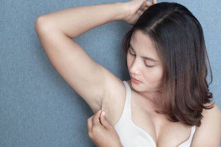 Women problem black armpit with grey background for skin care and beauty concept, selective focus Archivio Fotografico