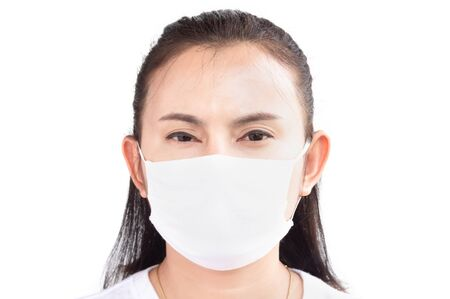 Closeup woman wearing face mask for protect air polution or virus covid 19 with headache on background, health care and medical concept