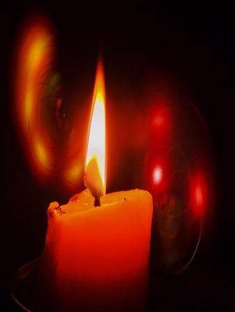 dark: Burning candle on dark background
