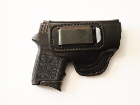 holster: Semi automatic pistol in holster Stock Photo
