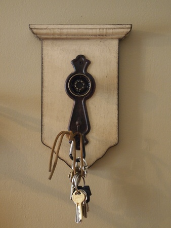 droop: key chain hook hanging on wall
