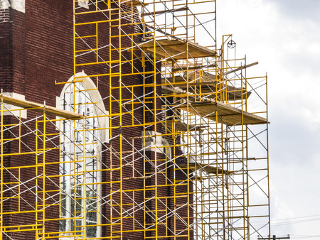Repairs on a church with scaffolding on the side