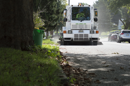 City street sweeper sweeping cleaning the road