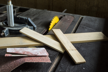table scraps: Wood scraps and sand paper on a table saw