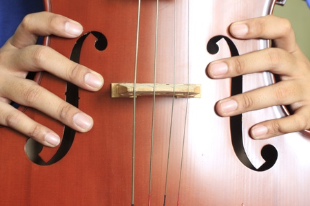 The Cello with hand Stock Photo - 13055314