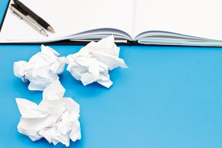 Used paper and blank page on the blue desk Stock Photo - 13117025