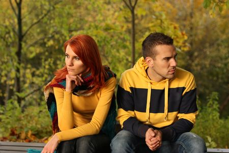 Young pair quarrel in park photo