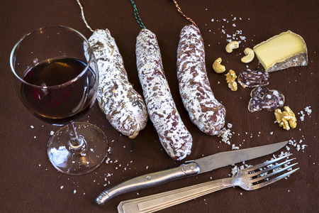 conviviality: Aperitif with red wine, salami, cheese and nuts