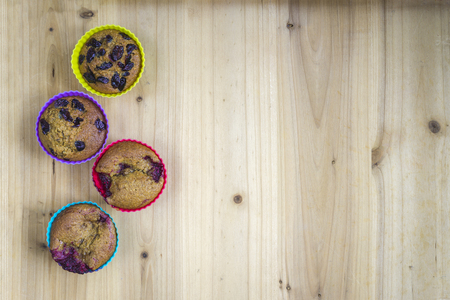 Home made muffins on wooden table