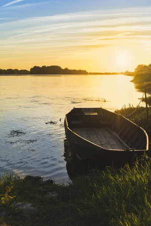 Loire river at sunset. Picture of the river loire with a small boat at sunset