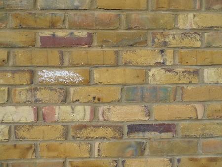 mustered: Yellow brickwall