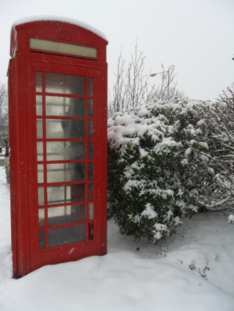 telephone box: Red phone box in snow close Stock Photo