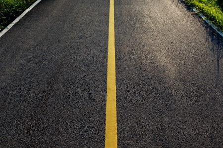 new asphalt road with yellow line before sunset Фото со стока - 20726789