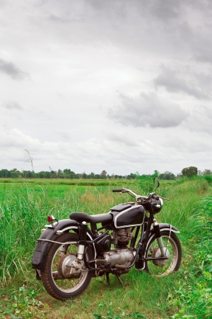 Old Motorcycle parking in Meadow can use for background photo