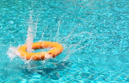 lifebuoy splash the water in the pool photo