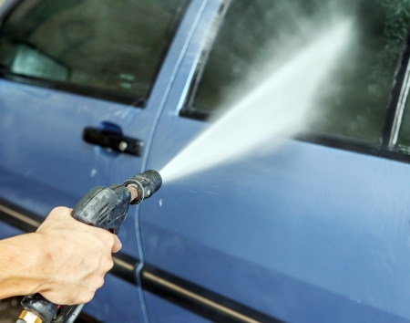 Car Washing Cleaning with High pressure Water at Service Station photo
