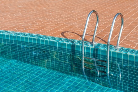 Swimming pool with stainless steel ladder photo