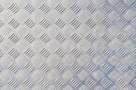 grunge diamond pattern metal plate background texture photo
