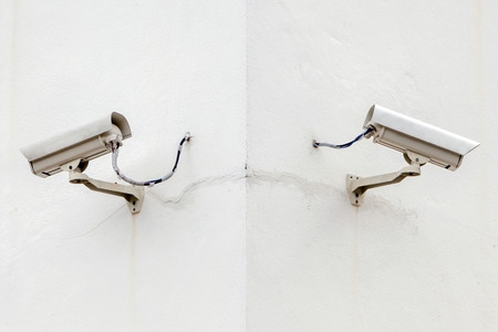 Security cameras, Two CCTV on the cone of the white building corner for closed monitoring photo