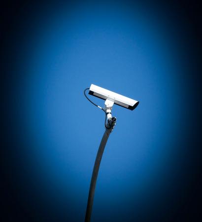 Security camera, CCTV on blue sky background photo