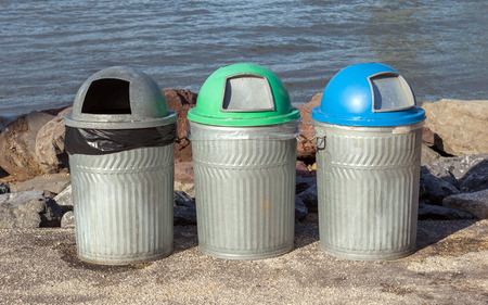 Three public trash cans for different kind of garbage beside riverside, Manhattan Bridge photo