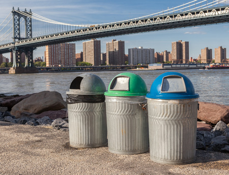 Recycle bins for different kind of garbage in front of the Manhattan Bridge photo