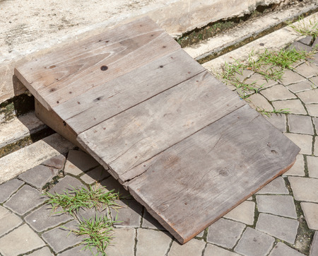 utilization: Utilization of wooden board for step or slide, on the Street