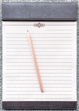 line lines luxury meeting: Blank notepad with pencil on the brown clipboard