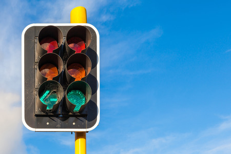 The grungy traffic lights with beautiful blue sky in backgrounds. photo