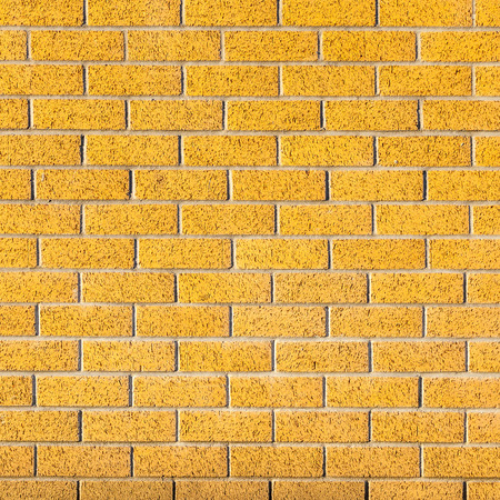 yellow block: Energetic yellow brick wall as a background image with black vignette.