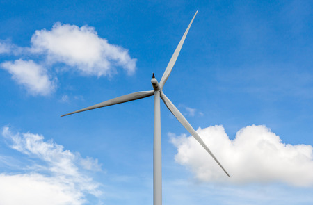From the behind of wind turbine in beautiful cloudy blue sky background, concept of renewable and clean energy. photo