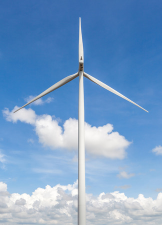 The big and white wind turbine against blue sky background, the concept of renewable electric energy production. photo