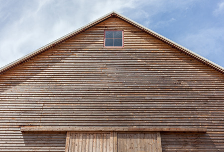 gabled: Looking up at the top of a gabled roof on a wooden barn