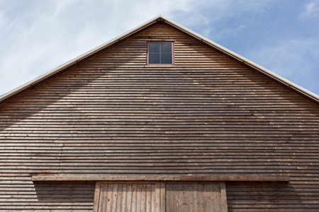 Looking up at the top of a gabled roof on a wooden barn photo
